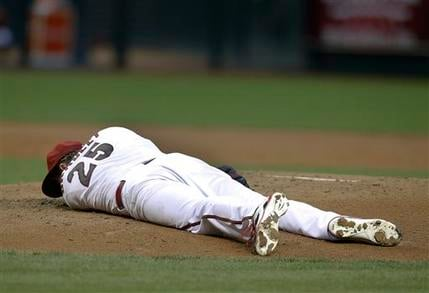 Arizona Diamondbacks pitcher Archie Bradley (25) lays on the mound in the second inning after getting hit with a line drive during a baseball game against the Colorado Rockies, Tuesday, April 28, 2015, in Phoenix. (AP Photo/Rick Scuteri)