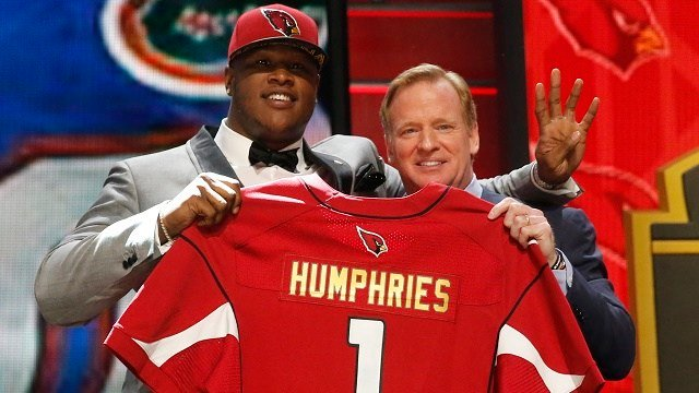 Florida offensive lineman D.J. Humphries poses for photos with NFL commissioner Roger Goodell after being selected by the Arizona Cardinals as the 24th pick in the first round of the 2015 NFL Draft, Thursday, April 30, 2015, in Chicago. (AP Photo/Charles)