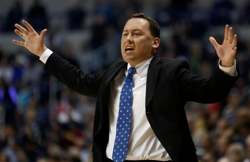 Northern Arizona head coach Jack Murphy reacts during the first half of an NCAA college basketball game against Xavier, Friday, Nov. 14, 2014, in Cincinnati. (AP Photo/David Kohl)