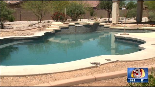 Tiffany Nitzsche calls her unfinished pool 'a giant cesspool pond' and a 'health hazard.' (Source: 3TV)