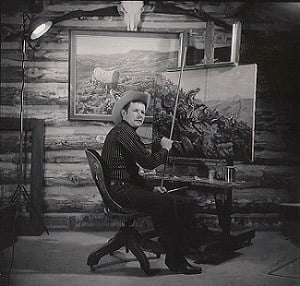 George Phippen in his cabin studio (Source: Phippen Museum)
