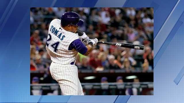 Arizona Diamondbacks' Yasmany Tomas follows through on a two-run double during the seventh inning of a baseball game against the Colorado Rockies, Thursday, July 2, 2015, in Phoenix. (AP Photo/Matt York)