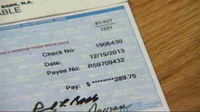 Roger McKee kept all of his paperwork, including a copy of the check from the insurance company. (Source: 3TV)