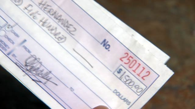 The Hernandez family handed over $10,000. (Source: 3TV)