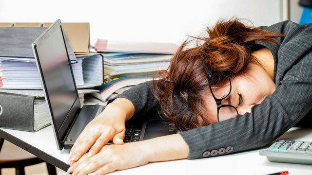 Have you ever caught a co-worker sleeping on the job? Ever dozed off on the clock yourself? (Source: Adisorn Saovadee via 123 RF)