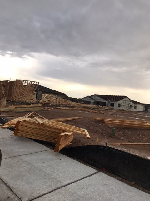 Strong winds damage structures, knock over power lines ...
