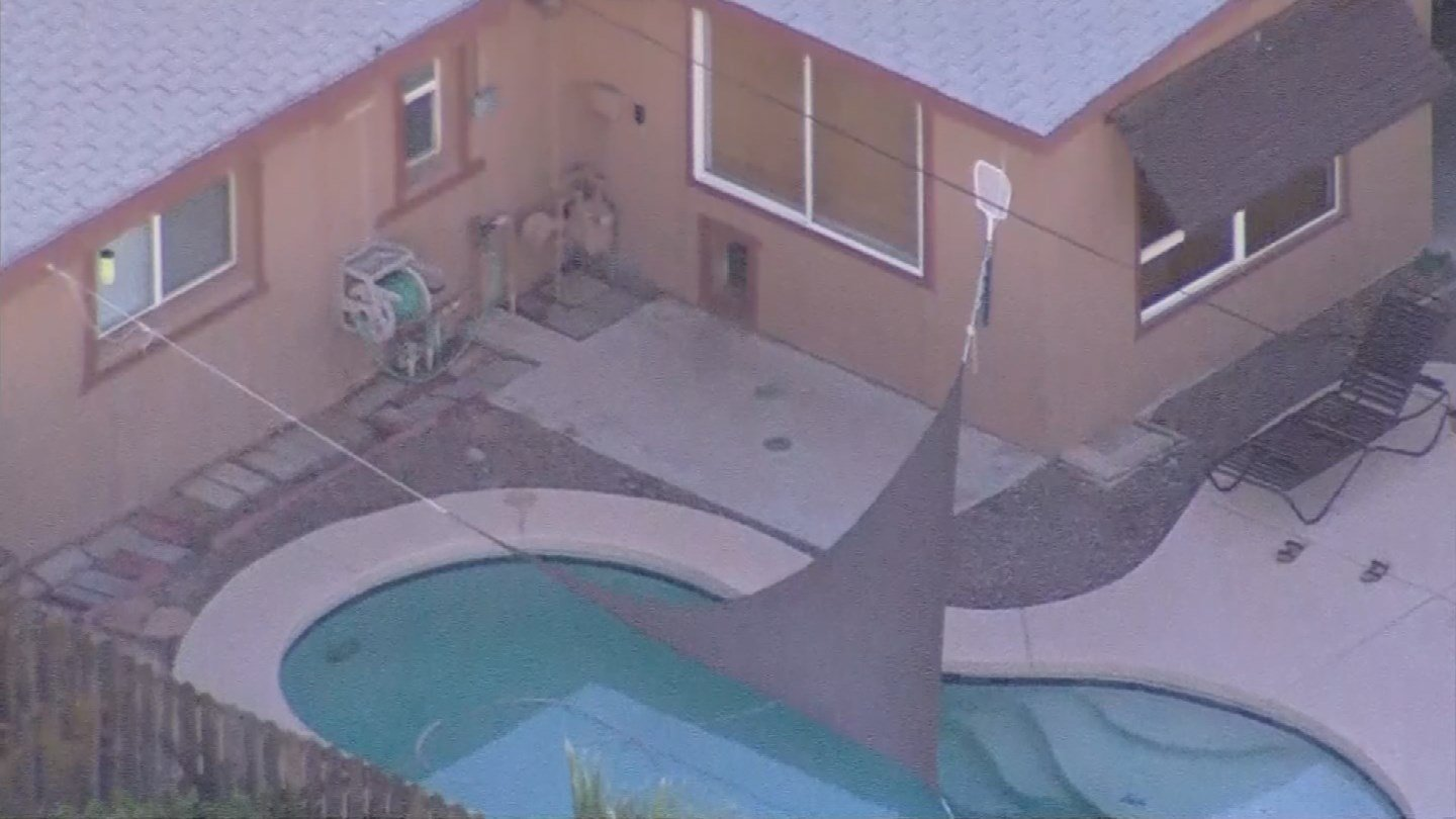 1 year old dead after crawling through dog door falling in