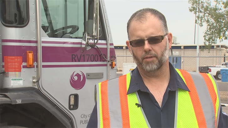 Scott O'Connor was driving by the Phoenix home in his garbage truck when he saw the flames. (Source: 3TV/CBS 5)