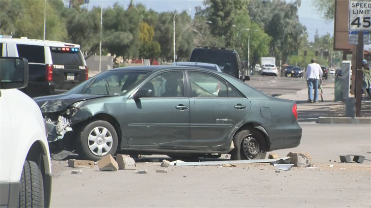 A driver lost control of his car and hit a woman, police said. (Source: 3TV/CBS 5)