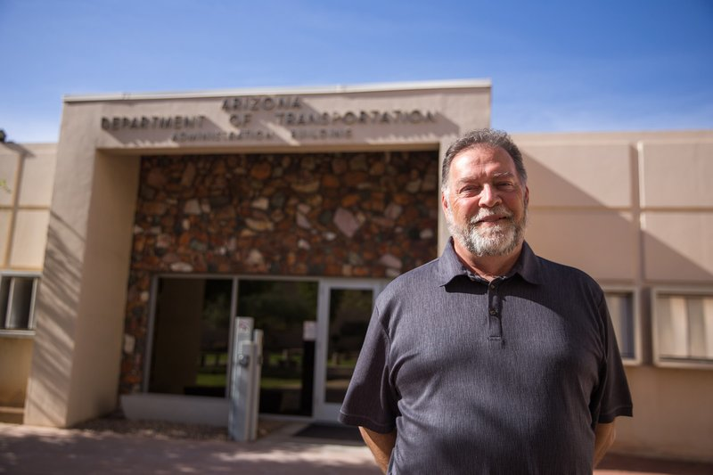 Arizona Department of Transportation spokesman Tom Herrmann, who is  standing outside the department's administrative building