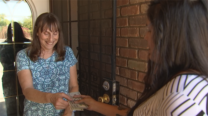 Millie Pepion decided to Pay It Forward to a Glendale family who had helps the community despite their own tough road ahead. (Source: CBS 5)