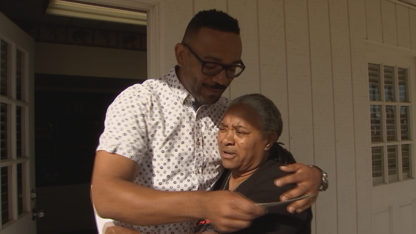 A CBS 5 news crew followed Mitchell on her bike, as she rode over to present Pastor Felipe with $500. (Source: 3TV/CBS 5)