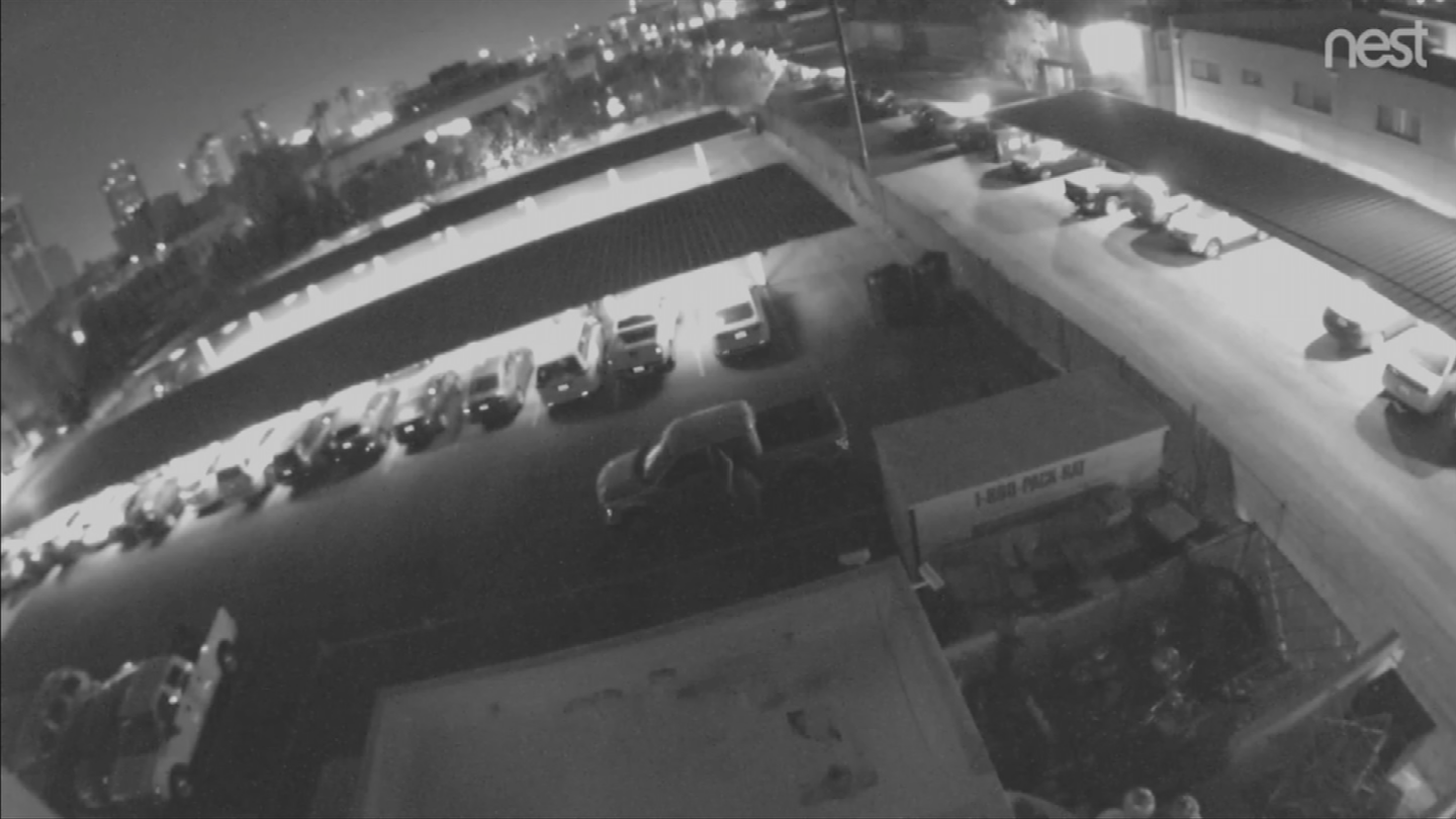After the break-in, two men returned overnight in a Ford F-150 pickup and appeared to search near the storage container. (Source: 3TV/CBS 5)