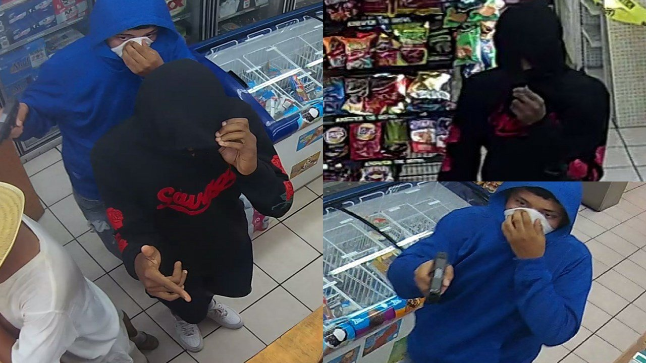 According to Silent Witness, two suspects entered the gas station and robbed the clerk at gunpoint. (Source: Phoenix Police Department)