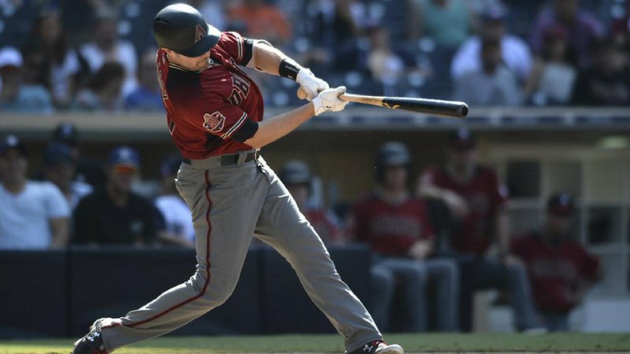 Arizona Diamondbacks' A.J. Pollock hits a home run during the ninth inning of a baseball game against the San Diego Padres Sunday, Aug. 19, 2018, in San Diego. (Source: AP Photo/Orlando Ramirez)