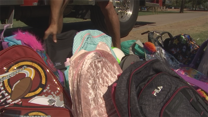 Two groups passed out backpacks to young students. (Source: 3TV/CBS 5)